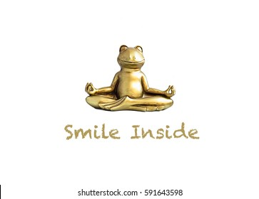 Smile inside. Gold yoga frog meditating in lotus pose. Body, mind and soul balance concept. Isolated on white