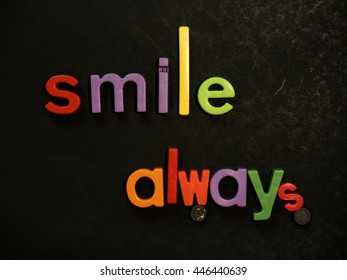 Smile! Inspirational message in vibrant colorful magnet letters