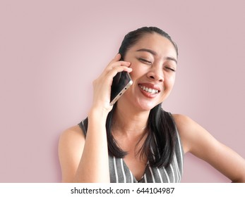 Smile and joyful Asian woman talking phone call on smartphone.