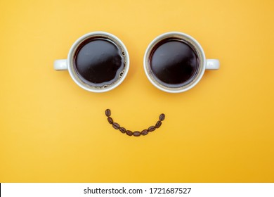 Smile look made from two cups of coffee and coffee beans