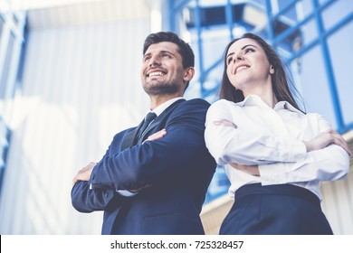 The smile man and woman stand on the background of the office center