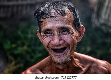 Smile of old man without teeth