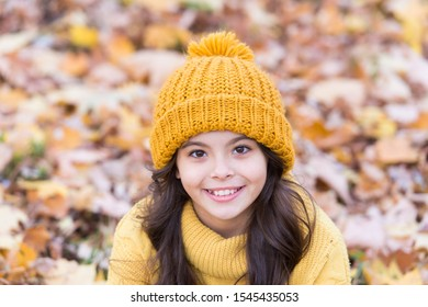 Smile of perfect beauty. Happy small child relax on autumn landscape. Natural beauty. Autumn beauty and fashion. Little beauty model in autumn style.