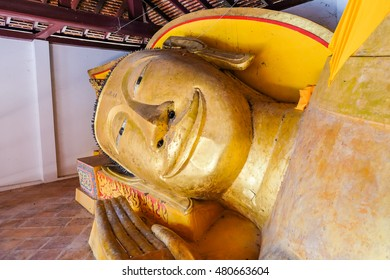Smile reclining buddha statue in nirvana position in Wat Pah-Koh at SongKhla Province, Southern of Thailand