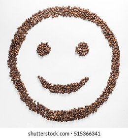Smile shaped coffee beans isolated on white background. composition for bloggers, designers, websites