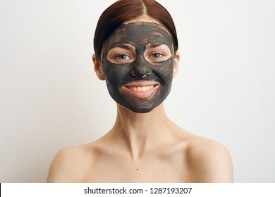 smile spa facial woman in cosmetic mask