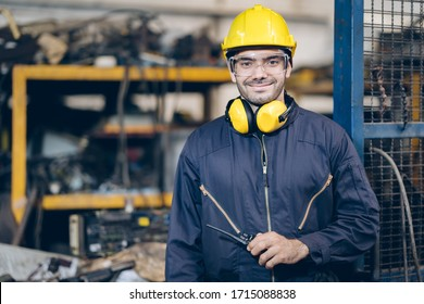 Smile technician Engineer man hold portable radio in factory