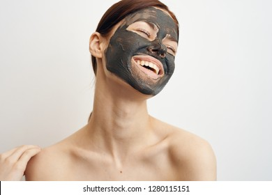 smile woman with eyes closed in clay mask care