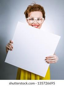 Smile woman holding blank white panel