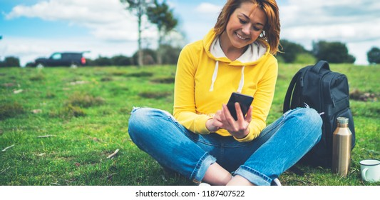 smile women holding in female hands gadget technology, tourist girl on background green grass using mobile smartphone, hiker texting finger message on screen online wifi internet lifestyle concept