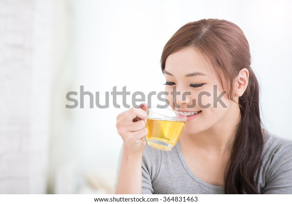smile young woman holding cup of  green tea at home, healthy lifestyle concept, asian beauty, asian beauty