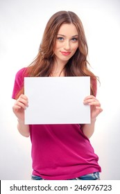 Smile young woman portrait with blank white banner, board on white isolated . Female model with long hair.