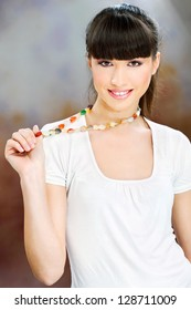 Smiled woman white dressed with necklaces