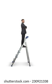 smiley businessman standing on the pair of steps and looking at camera. isolated on white background