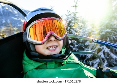 smiley child in a mountain-skiing helmet and points is represented on the ski lift