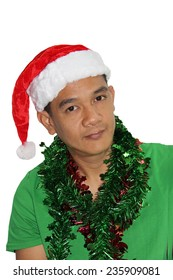 Smiley Christmas man wearing a green t-shirt and santa hat isolated on white.