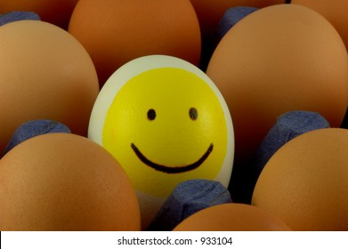 smiley easter egg in an egg tray
