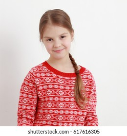 Smiley kid wearing beautiful red sweater