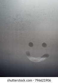 Smiley line on fogged bus window