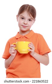 smiley little girl with yellow tea cup