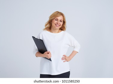 Smiley mature blond with documents