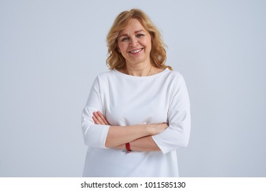 Smiley mature woman posing