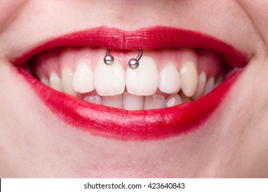 Smiley Piercing Detail with Smiling Woman's Mouth