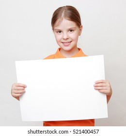 Smiley teen girl with white blank for advertisement