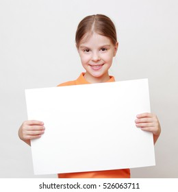 Smiley teen girl with white blank for advertisment