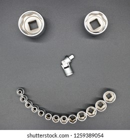 Smiley of tools: heads for socket wrench and cardan