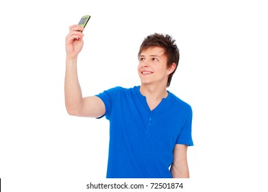 smiley young man taking picture on phone. isolated on white background