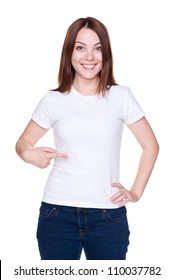 smiley young woman pointing at her white t-shirt