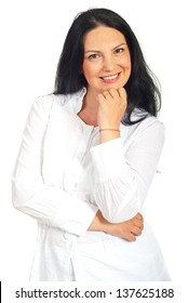 Smilign casual woman in white clothes holding hand to chin isolated on white background