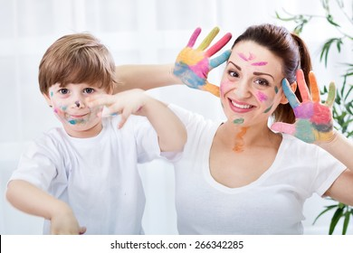 Smiling adorable family enjoy in colors at home