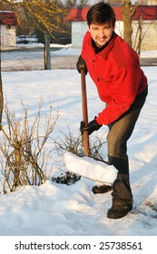 smiling adult man clean owns yard against snow