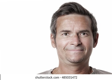 Smiling adult man on white background