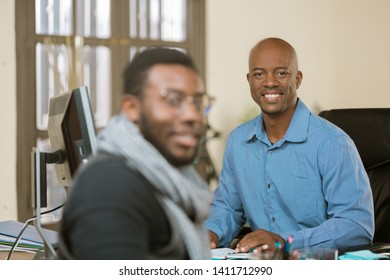 Smiling African American man with client or coleague