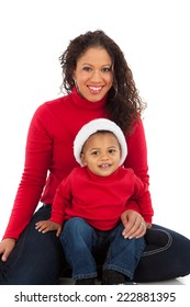 Smiling African American Mom and Boy Wearing Christmas Outfits Portrait on White Background Wearing Holiday Red