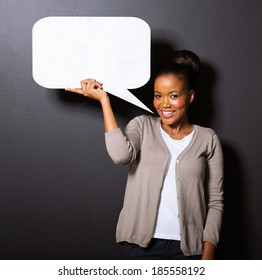 smiling african american woman holding paper speech bubble