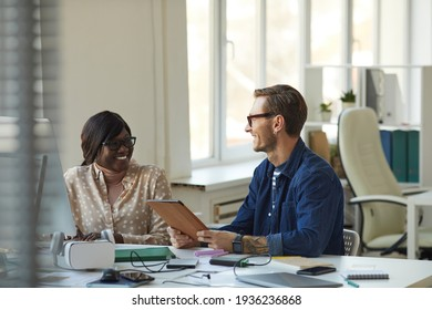 Smiling African American Woman Talking to Boss in Office