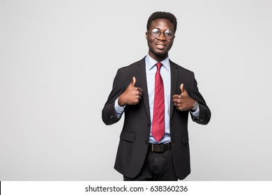 Smiling african black executive professional giving a thumbs up in studio