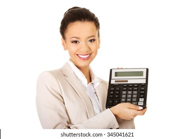 Smiling african business woman with a calculator.