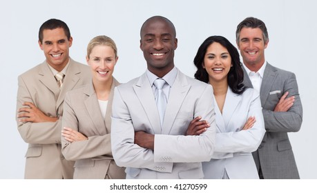 Smiling African businessman leading his team against white background