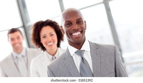 Smiling African businessman in a row