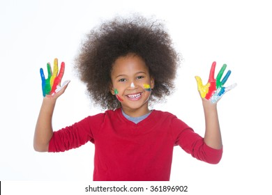 smiling african child with painted hands