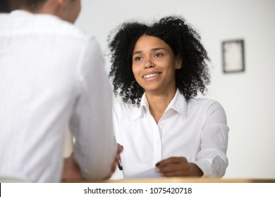 Smiling african female hr employer interviewing male job applicant asking questions, black recruiter attentively listening to seeker, good first impression, human resources management concept