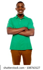 Smiling african guy with crossed arms against white background