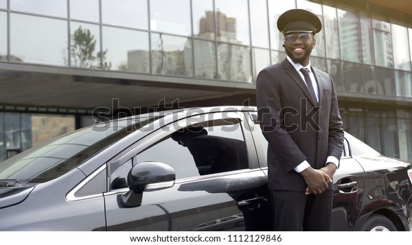 Smiling Africanamerican Taxi Service Driver Expecting Stock Photo