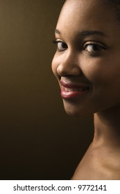 Smiling African-American young adult female looking at viewer.