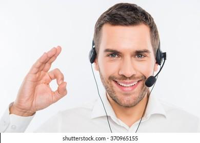 "Smiling agent of call centre gesturing ""OK"""